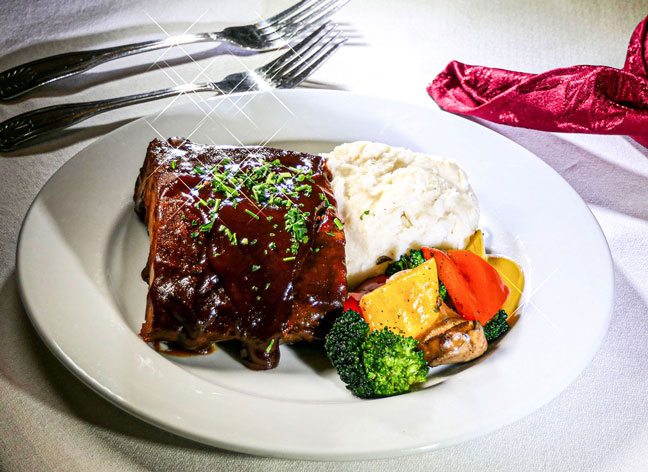 BBQ Pork Ribs – sweet BBQ pork ribs, served with mashed potatoes and mixed vegetables